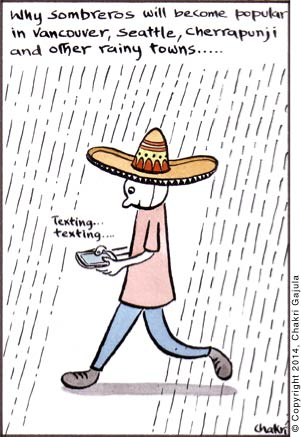 A young man wearing a sombrero, walking and texting with a caption 'Why sombreros will become popular in Vancouver, Seattle, Cherrapunji and other rainy towns'