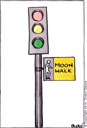 Traffic signal: The walk signal shows 'Moon Walk